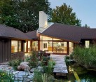 Modern Ontario home with private deck, garden and natural pond