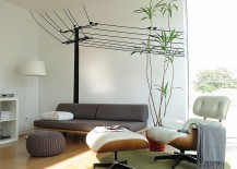Modern family room with the Case Study Daybed and the Eames Lounger