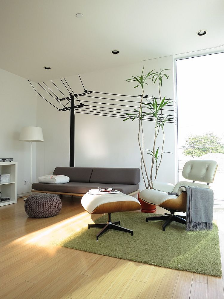 Modern family room with the Case Study Daybed and the Eames Lounger [Design: ras-a, inc.]
