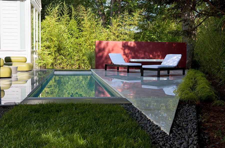 narrow pool plays to the dimensions of the modern house design anthony wilder design