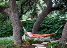 Natural greenery offers ample privacy in this Austin backyard