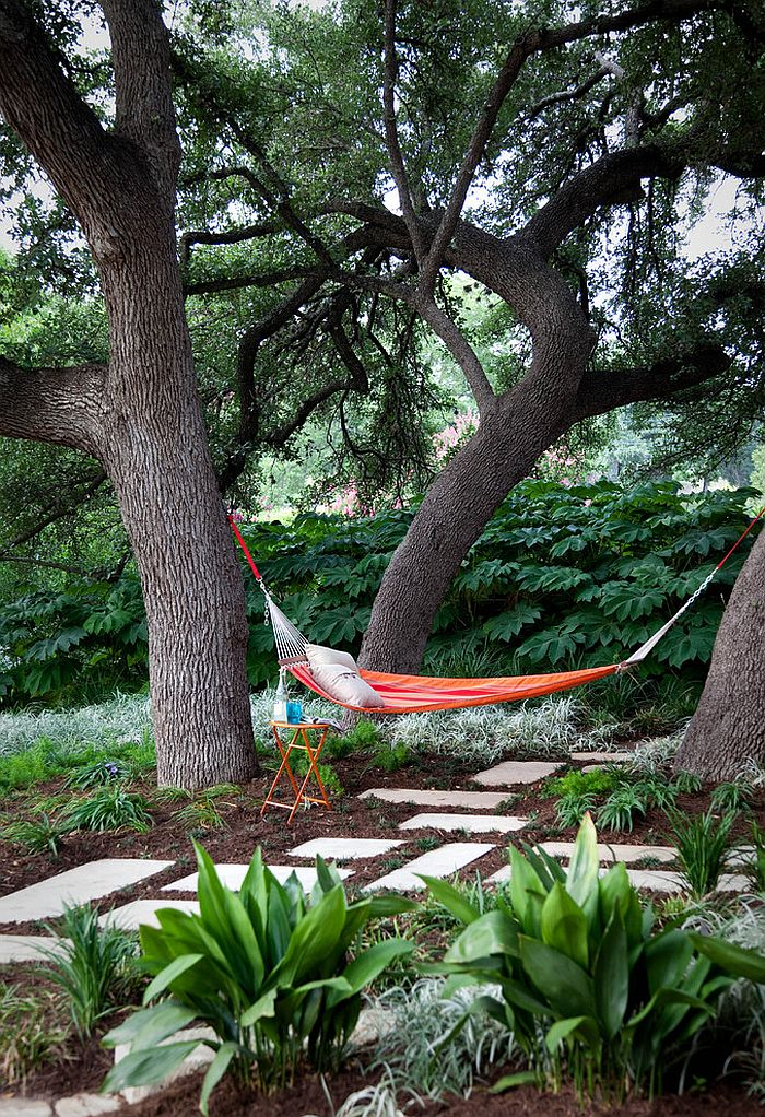 Natural greenery offers ample privacy in this Austin backyard [Design: B. Jane Gardens]