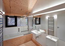 Neutral-color-scheme-and-slanted-wooden-ceiling-inside-the-modern-bath-217x155