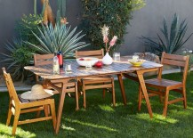 Outdoor dining area surrounded by plants 217x155 10 Outdoor Dining Spaces That Double as Relaxing Retreats
