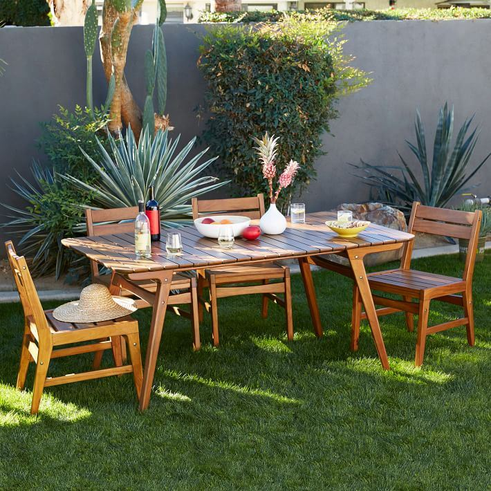 Outdoor dining area surrounded by plants