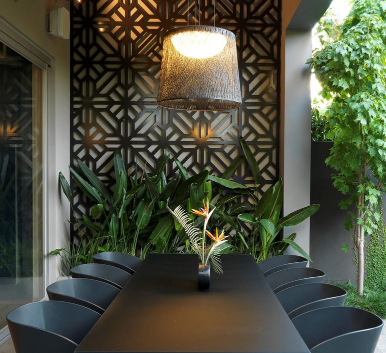 Outdoor dining space with deep tones