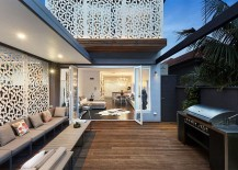 Outdoor sitting area flows into the living room indoors 217x155 Bright Single Family Home in Sydney Combines Privacy with Chic Elegance