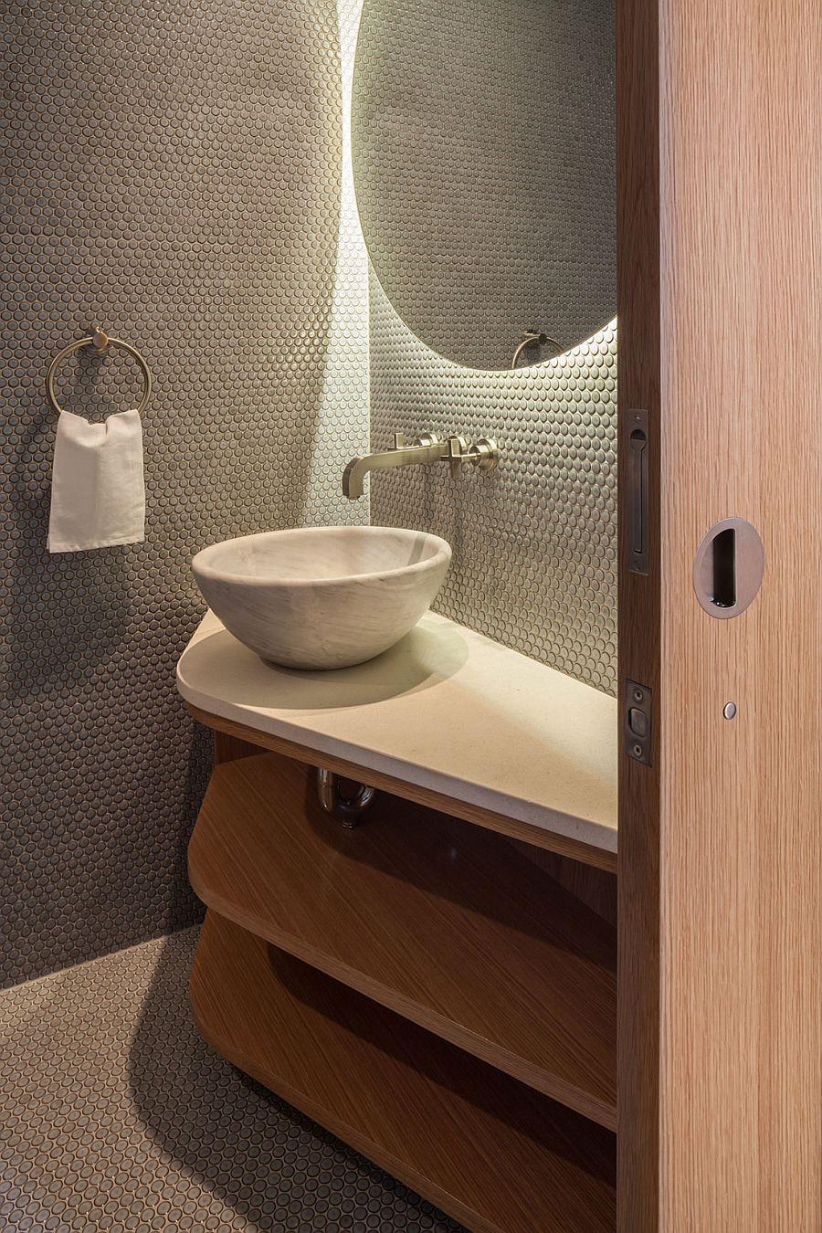 Penny tiles create a unique backdrop in the bathroom