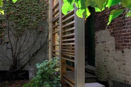 Plants at the base of a modern trellis  How to Style a Trellis Plants at the base of a modern trellis 270x180