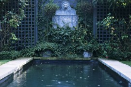Plants at the base of a trellis in an elegant garden  How to Style a Trellis Plants at the base of a trellis in an elegant garden 270x180