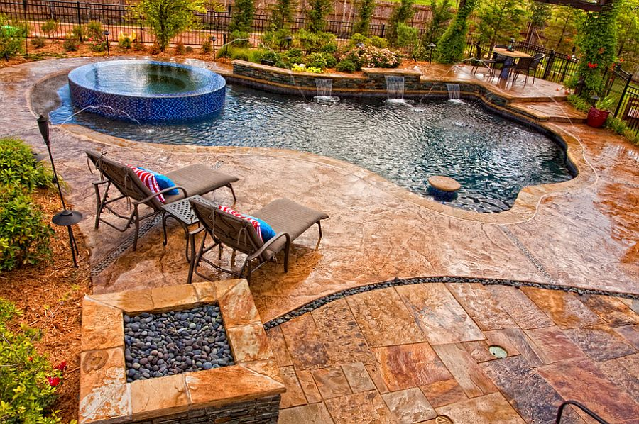 Pool deck in stamped concrete with slate skin pattern looks amazing [Design: Sam's Outdoor Living]