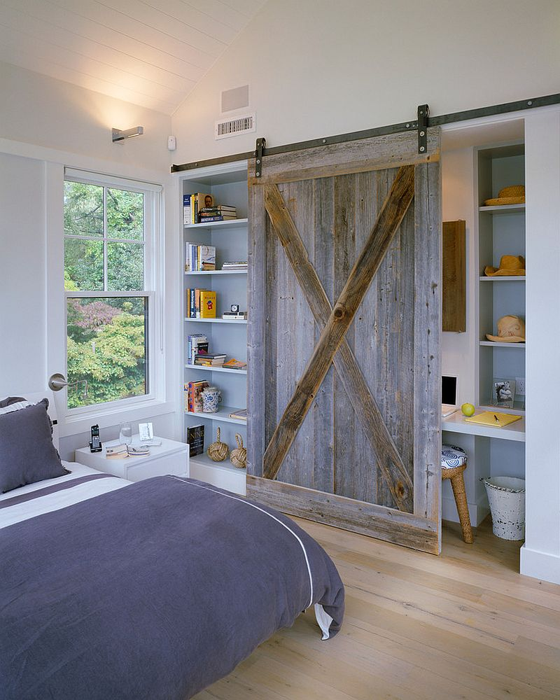25 bedrooms that showcase the beauty of sliding barn doors reclaimed barn wood door for the bedroom shelf and office nook design hutker architects