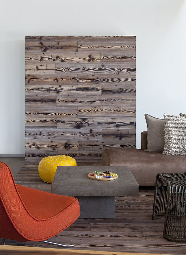 Reclaimed wood shapes a lovely feature wall in the living room [Design: DuChateau Floors]