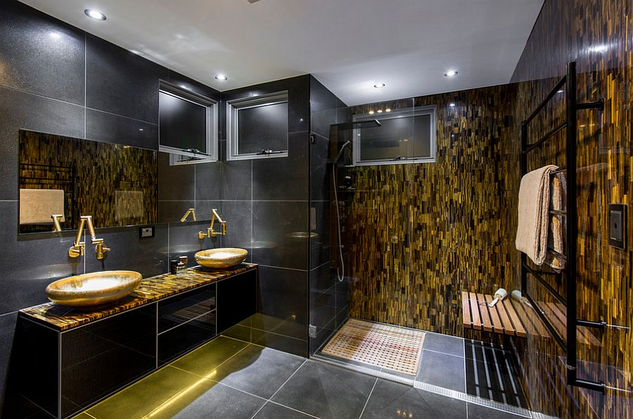 Red Tigers Eye stone feature wall adds gold to the glam bathroom [From: Enigma Interiors]