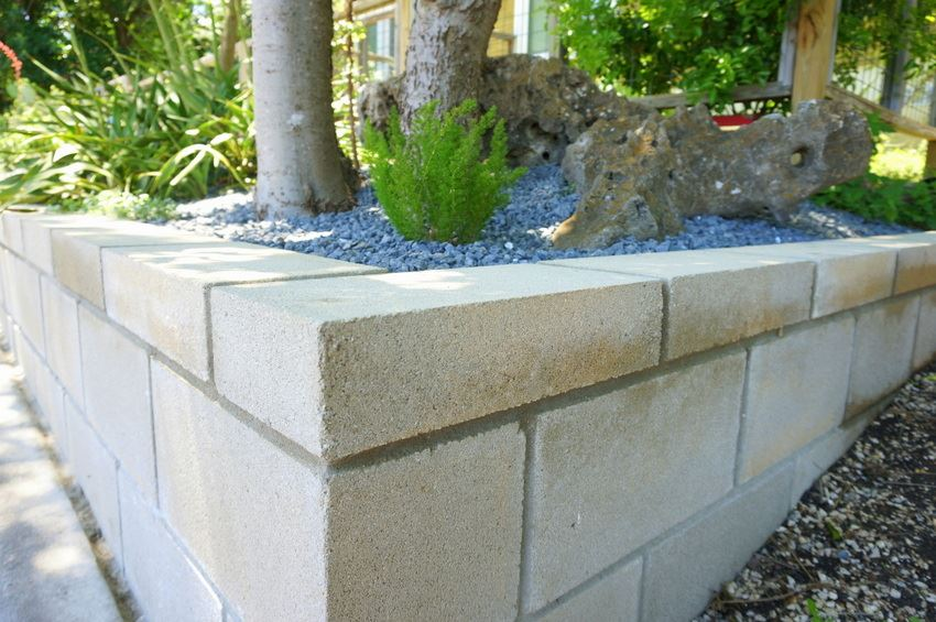 A diy cinder block retaining wall project for Concrete block walls design
