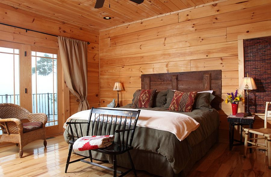 Rustic bedroom with barn wood headboard [Design: Log Homes of America]