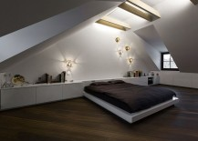 Santed ceiling adds a unique appeal to the stunning attic bedroom