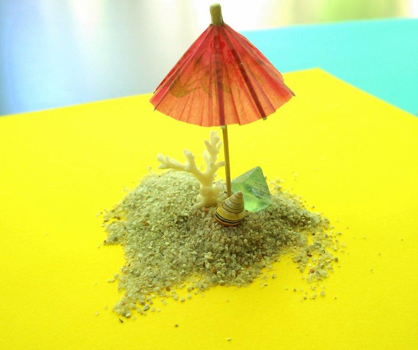 Seashells, fluorite and a drink umbrella