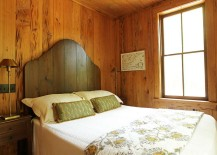 Simple wooden headboard adds to the beauty of the rustic, elegant bedroom