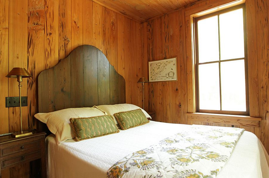 Simple wooden headboard adds to the beauty of the rustic, elegant bedroom [Design: Margaret Donaldson Interiors]