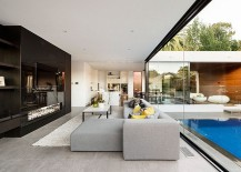 Sitting-area-wih-glass-sliding-doors-make-up-the-contemporary-extension-217x155