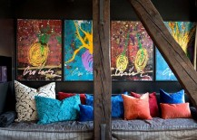 Sitting-area-with-colorful-throw-pillows-and-equally-captivating-wall-art-217x155