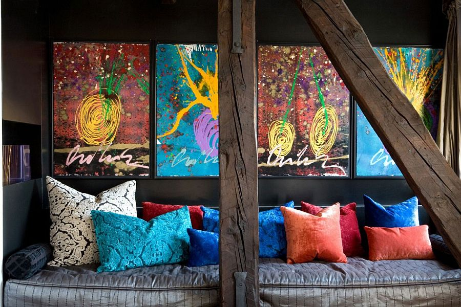 Sitting area with colorful throw pillows and equally captivating wall art