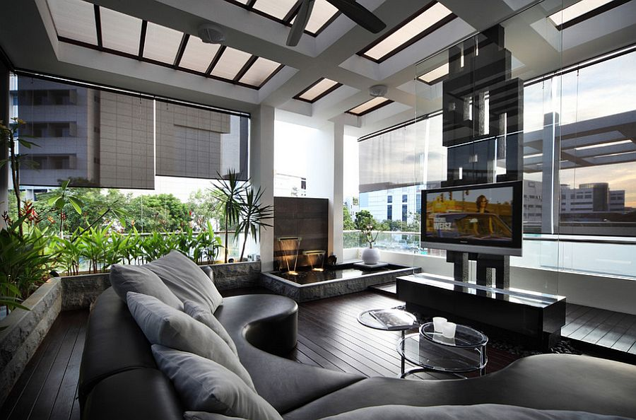 Sleek contemporary living room with a cool water feature [Design: The Interior Place (S) Pte Ltd]