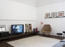 Sleek entertainment unit inside the apartment has a minimal, modern style