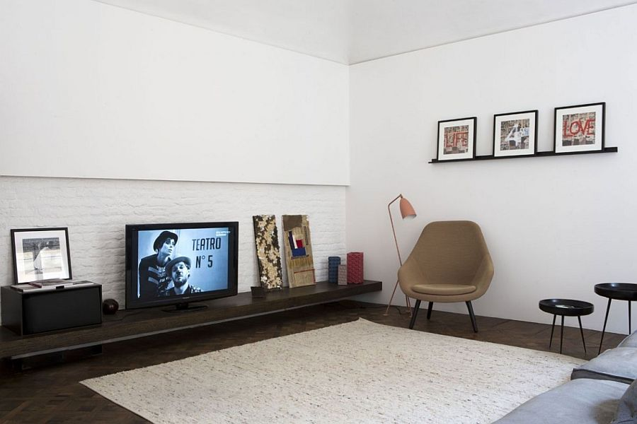 Sleek entertainment unit inside the apartment has a minimal, modern style