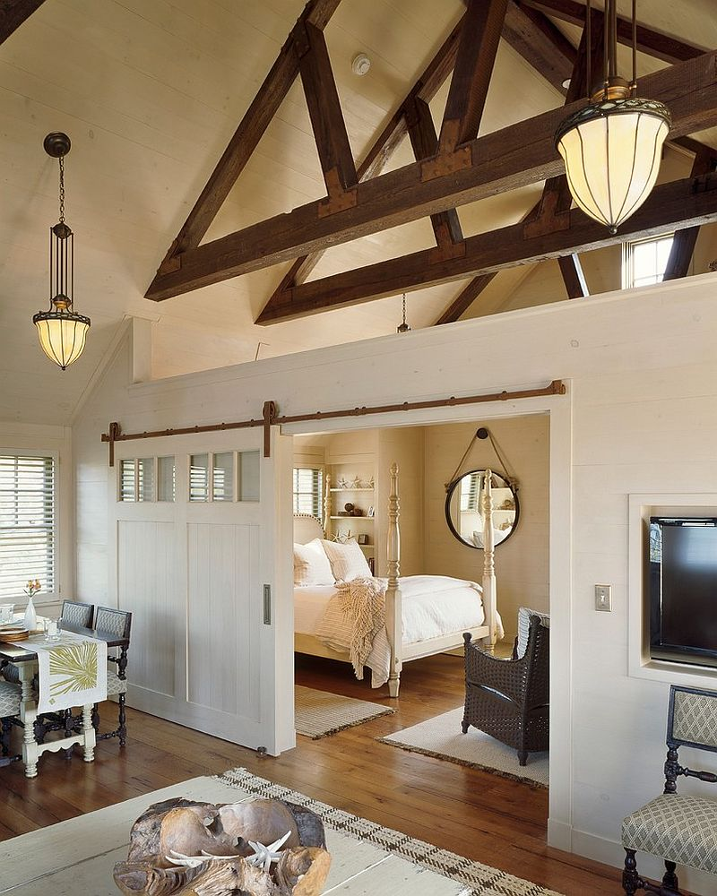 sliding barn door separates the living area from the bedroom design