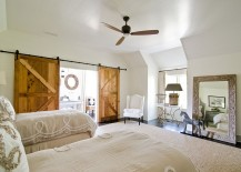 Sliding barn doors add texture to the cool bedroom