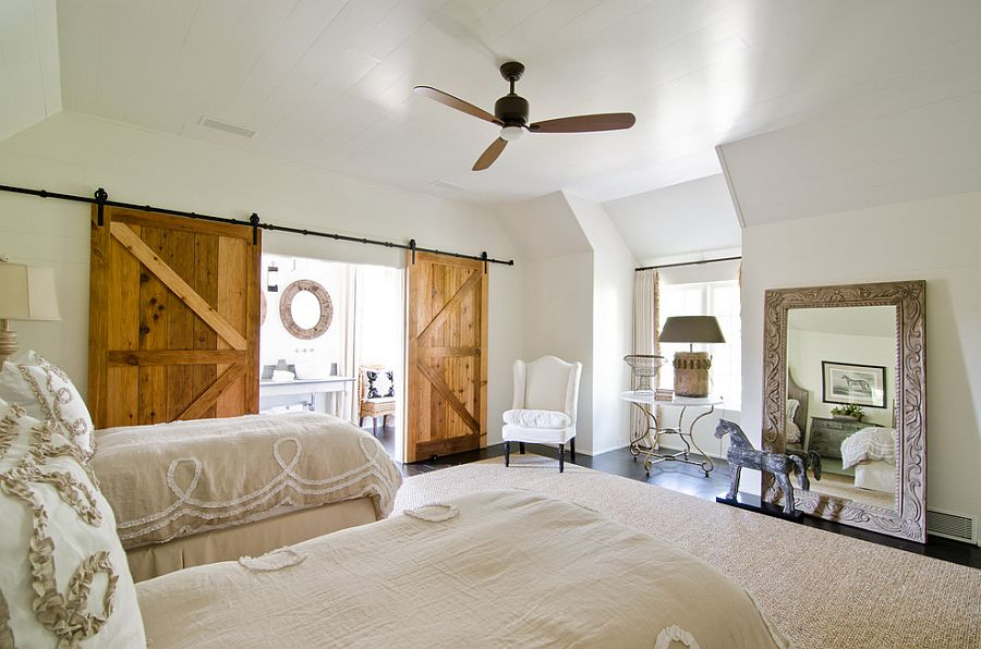 Sliding barn doors add texture to the cool bedroom [Photography: Virtual Studio Innovatons]