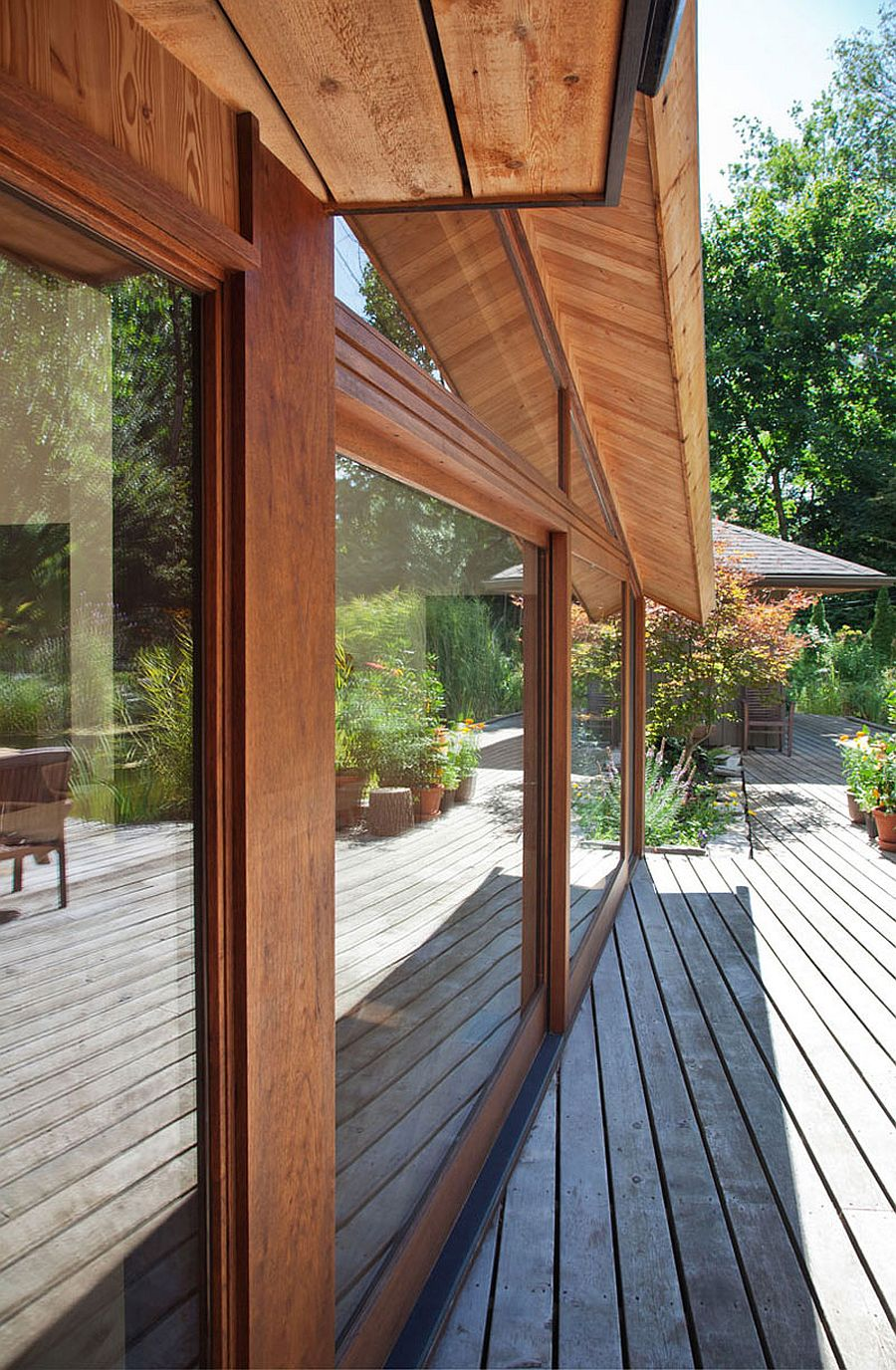 Sliding glass doors that connect the home with the deck outside