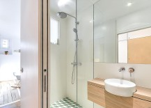 Small bathroom inside the apartment with glass shower area