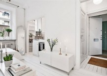 Small living area of the apartment in white with ample natural light 217x155 Ultra Small Studio Apartment in Stockholm with Smart Scandinavian Design