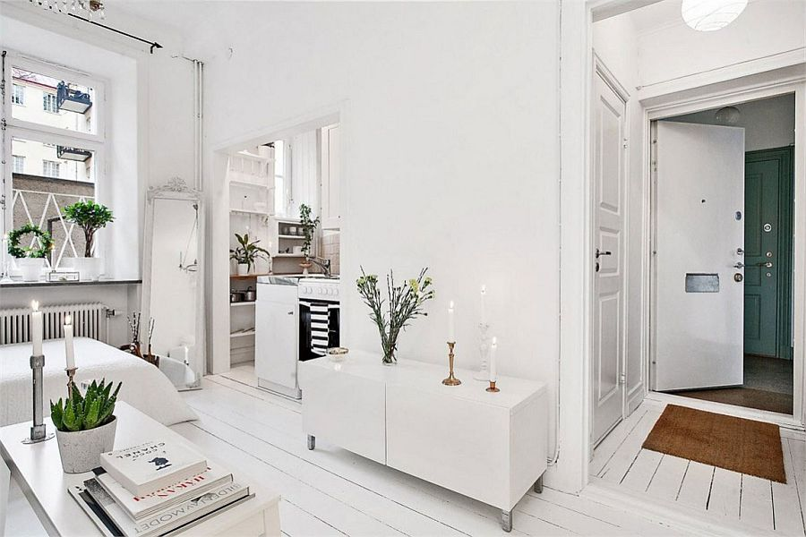 Small living area of the apartment in white with ample natural light
