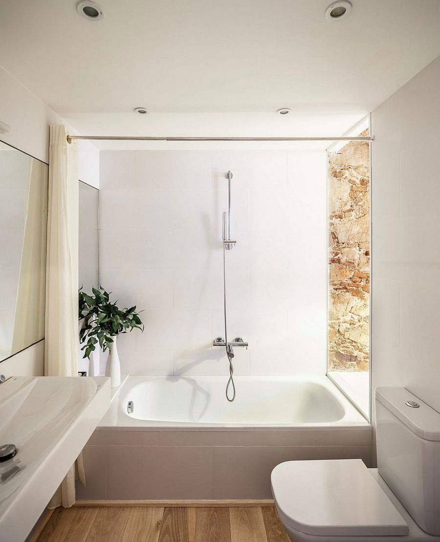 Smart, small bathroom design combines natural stone with all-white modern surfaces