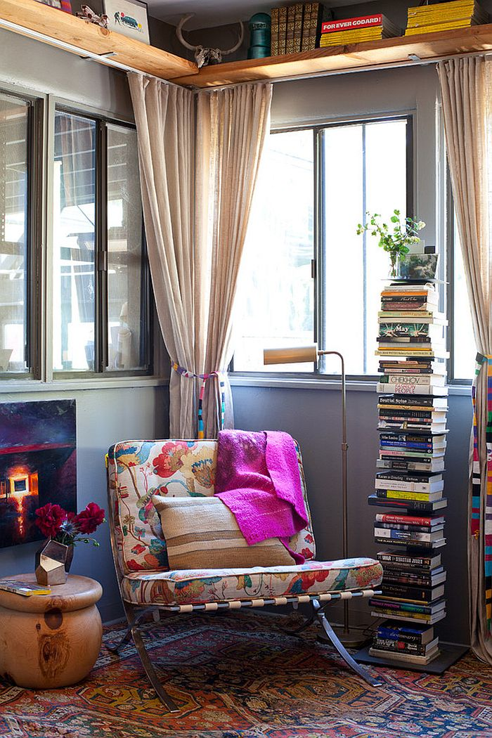 Smart way to stack up the books in the reading nook [Design: Kimberly Stevens / Photography by Teri Lyn Fisher]