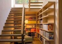Space-under-the-staircase-is-used-as-a-reading-nook-217x155