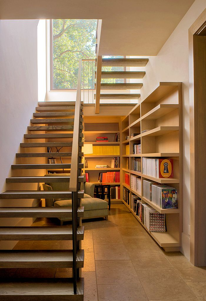 Space under the staircase is used as a reading nook [Design: Total Concepts]