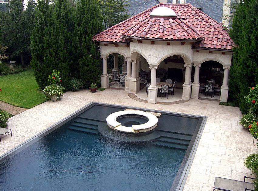 Stamped concrete pool deck is both aesthetic and durable [Design: Harold Leidner Landscape Architects]