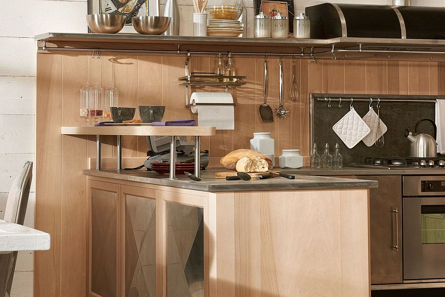 Steel worktop and wooden cabinets shape the kitchen workstation