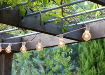 String lights hang from an overhead trellis