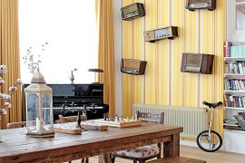 Striped yellow wallpaper in the modern dining room