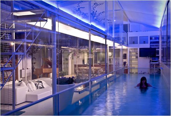 Stunning Pool Inside Glass Home