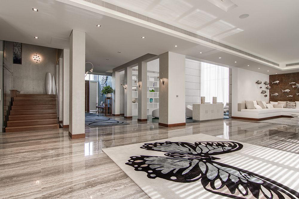 View In Gallery Stunning Entrance With Custom Design Fetaures And Artwork