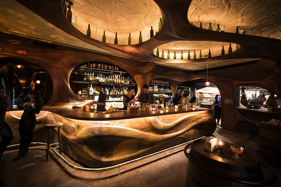 Stunning interior of Bar Raval Toronto draped in CNCd mahogany Bar Raval Toronto: Art Nouveau Meets Intoxicating Design in Sculpted Mahogany!
