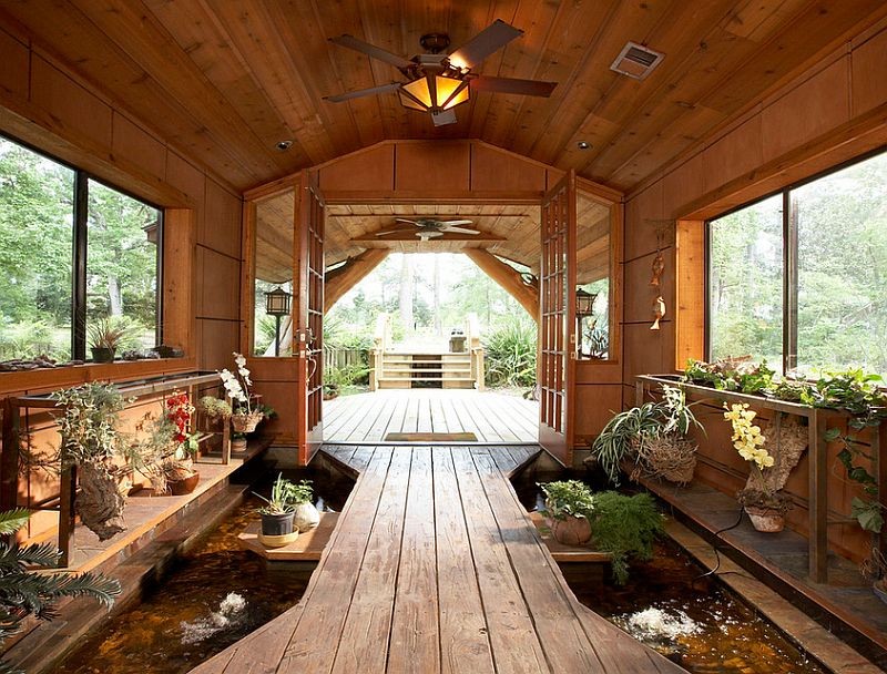 Stunning pond at the entry brings the outdoors inside [Design: Vacation Home Builders]