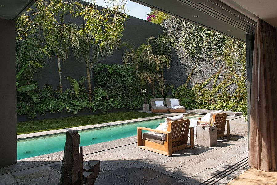 Stunning pool area and garden landscape shape the exterior